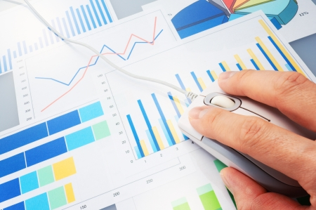 Graphs and mouse  Analyzing finances Stock Photo - 24693503