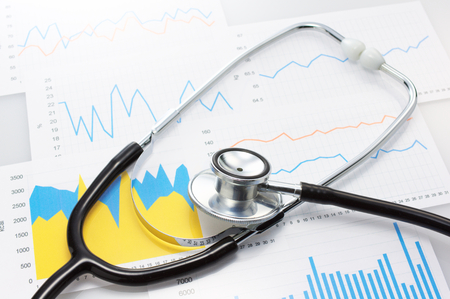 Results of a medical and stethoscope  Close up of graphs and stethoscope  Archivio Fotografico