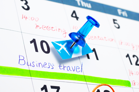 scheduling: Scheduling a business travel  Calender and pushpin