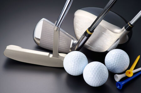 Golf clubs, driver, iron, putter, balls and tees.   photo