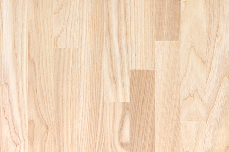 Natural color wood texture background. Closeup of wood panel. Vertical grain.