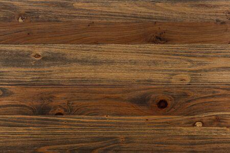 Uitstekende houten achtergrond. Donkerbruine houten panelen. Horizontale graan.