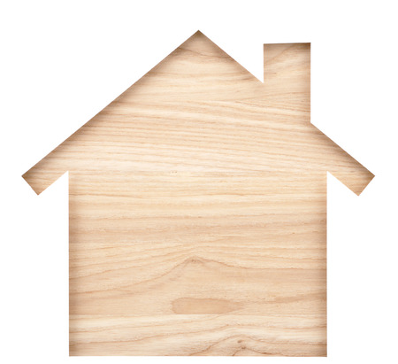 paper cutout: House shaped paper cutout on natural wood lumber. Isolated on white background.