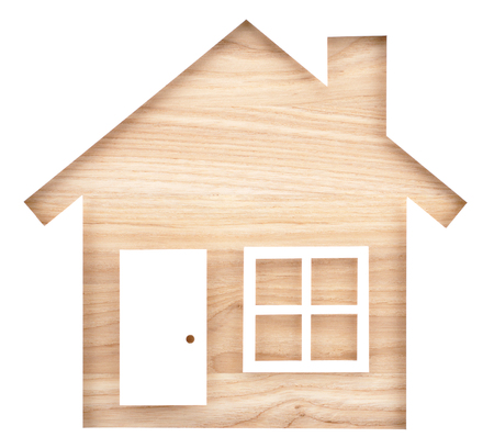 House shaped paper cutout on natural wood lumber. Isolated on white background.