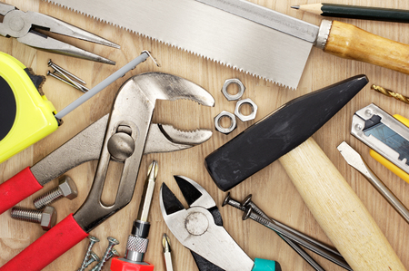 hardware tools: Close up of tools on wood lumber. Saw, hammer, plyer, and measure wood timber. Stock Photo