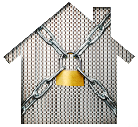 paper cutout: House shaped paper cutout and padlock on punching metal. Isolated on white background.