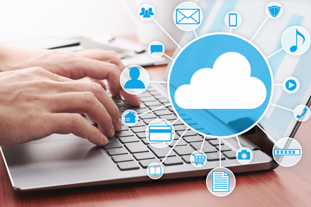 Cloud computing concept image. Using laptop for internet application.