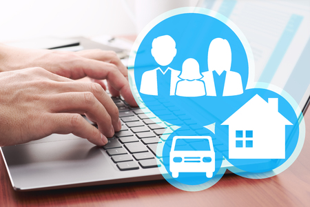 Insurance of house, car and family life concept. Online applying for insurance. Laptop and family icons. Stock Photo