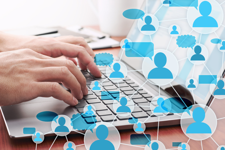 Communication in social media. Online people network structure. Man sending the message by laptop. Stock Photo