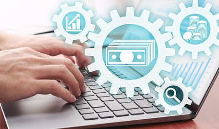 Asset management concept. Businessman using laptop for analyzing financial data.