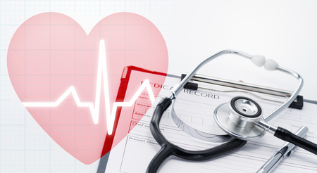 Health care and healthy heart concept image. Pink heart icon with cardiogram. Stethoscope on medical record.