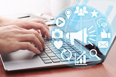 Digital marketing concept. Businessman accessing to social media.Using laptop for internet.