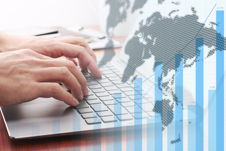 Global business analytics. Businessman analyzing data. Growth graph, world map and laptop.