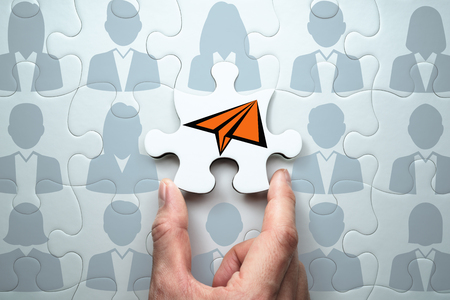 Business leadership concept. Clearly communicating vision to team. Connecting last jigsaw puzzle piece.