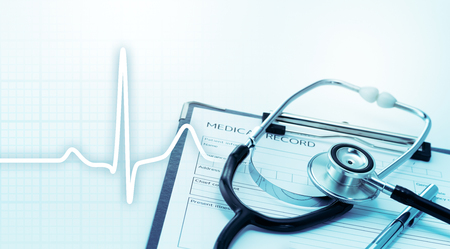 Stethoscope and heartbeat.  Health care and Medical concept. Stethoscope on medical record. Stock Photo