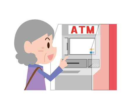 An old woman using a cash machine