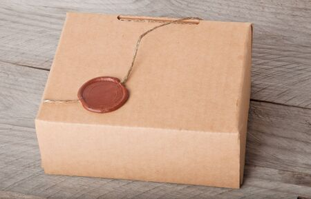 paper box on a wooden background photo