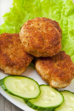 chicken cutlet with vegetables photo