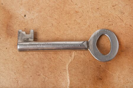 the old key on the background of the old paper Stock Photo - 14964374