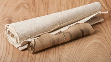 ancient scroll: old scroll and the old canvas on wooden background
