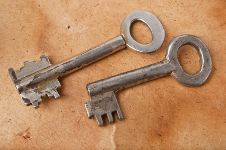 ornamented: old keys on the background of the old paper