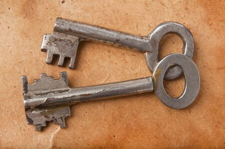 the old keys on the background of the old paper Stock Photo - 15042833