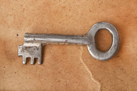 the old key on the background of the old paper Stock Photo - 15042886