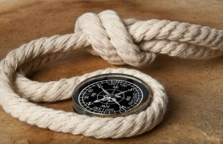 yellow boats: old compass and rope on grunge background