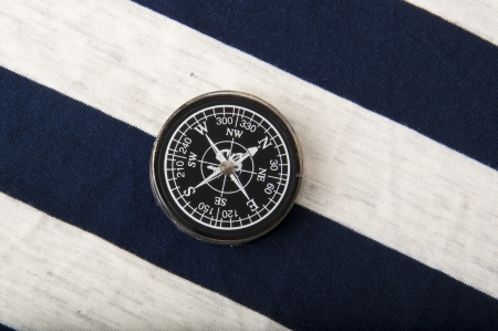 Old compass on the background of a sailor dress photo