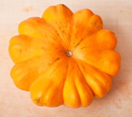 cymbling: fresh squash on a background of wood