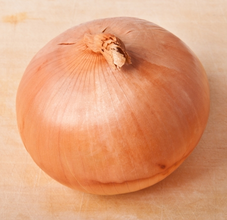 onions on a wooden background photo