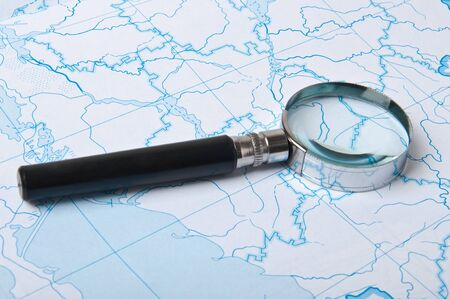 magnifying glass on the map background photo