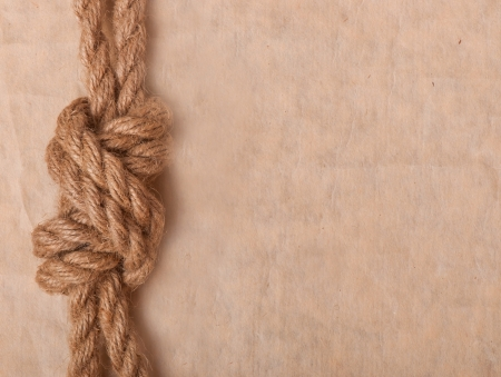 slipped: marine knot on the background of old paper