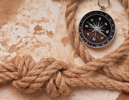 knot and compass on old paper background photo