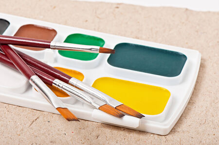 watercolor paints and brushes for painting photo