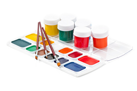 watercolor paints and brushes for painting on a white background photo