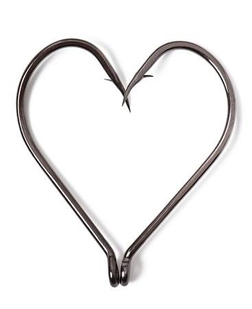 fish hooks in heart shape on white background photo