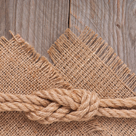 ship rope on wooden texture background photo