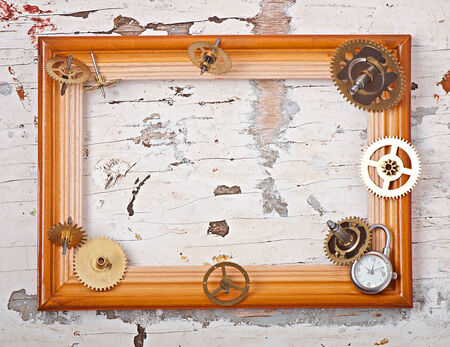wooden frame and mechanical clock gears photo