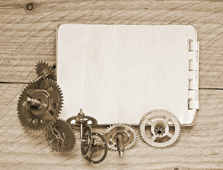 Notebook and gears of the clock photo