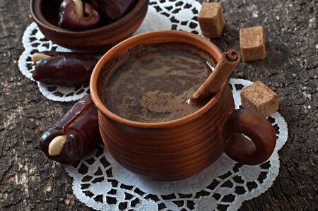 eastern: aromatic coffee and eastern dates Stock Photo