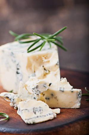 danish: Blue cheese on the old wooden background.