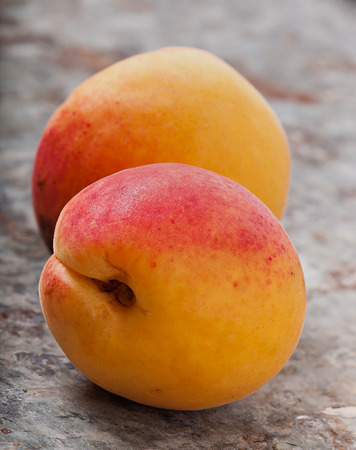 Fruits of an apricot on an old metal background, diet food. Stock Photo