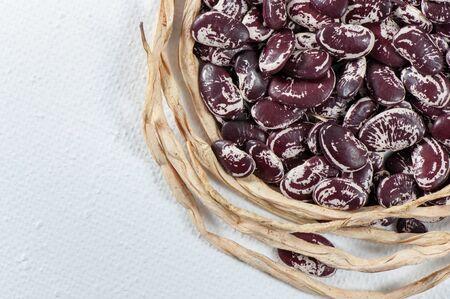 Ripe grain beans on a light background.