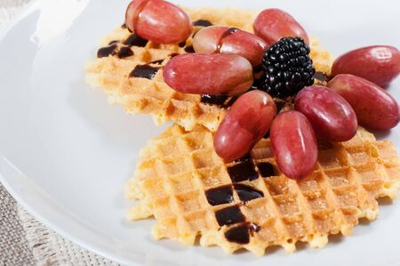 Sweet waffles with fruit on a light background. Stok Fotoğraf