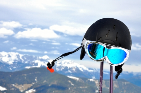 Winter panorama of Alps in Austria and ski equipment photo