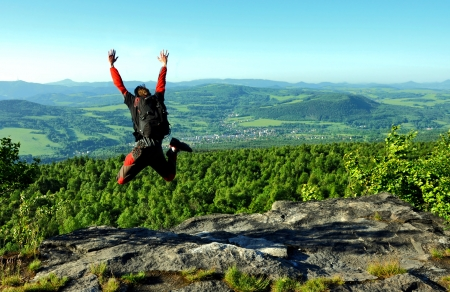 skydiver jumps from the hill photo