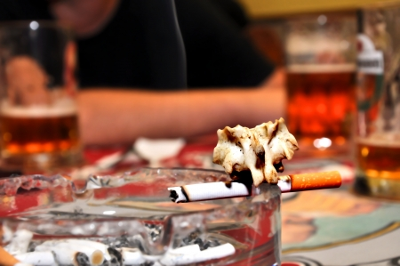smoking cigarettes in pub, drinking - death  photo