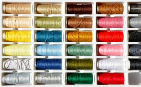detail of embroidery yarn bobbins photo