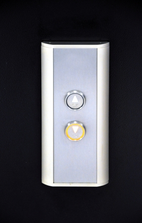 waiting, metallic elevator buttons, office centre Stock Photo